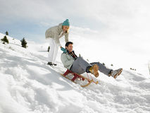 Young Couple Sledding Royalty Free Stock Photography