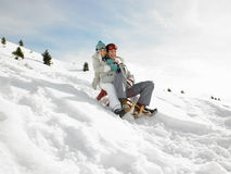 Young Couple Sledding Royalty Free Stock Photos