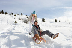 Young Couple Sledding Royalty Free Stock Images