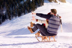 Young Couple Sledding And Enjoying On Sunny Winter Day Royalty Free Stock Photography
