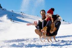 Young Couple Sledding And Enjoying On Sunny Winter Day Royalty Free Stock Image
