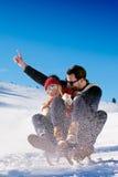 Young Couple Sledding And Enjoying On Sunny Winter Day Royalty Free Stock Photo