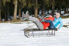 Young couple on the sledge Stock Image