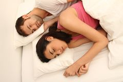 Young couple sleeping. In bed stock photos