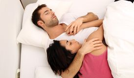 Young couple sleeping. In bed royalty free stock photo