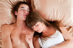 Young couple sleeping. In a bed Royalty Free Stock Image