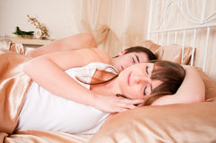 Young couple sleeping Stock Images