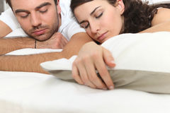 Young couple sleeping. Together in bed Royalty Free Stock Photos