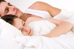 Young couple sleeping Stock Photos