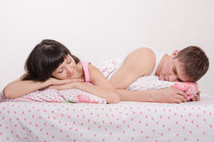 Young couple sleeping in bed Stock Images