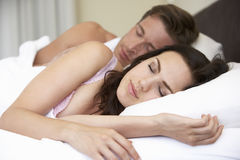 Young Couple Sleeping On Bed Royalty Free Stock Images