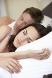Young Couple Sleeping On Bed Royalty Free Stock Image