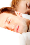 Young couple sleeping in bed.  Royalty Free Stock Images