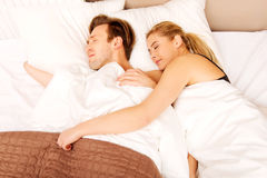 Young couple sleeping in bed.  Stock Photography