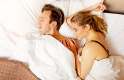 Young couple sleeping in bed.  Royalty Free Stock Photography