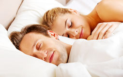 Young couple sleeping in bed.  Stock Photos