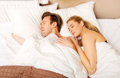 Young couple sleeping in bed.  Royalty Free Stock Photos
