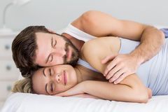 Young couple sleeping on bed. In bedroom Stock Photography