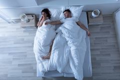 Young Couple Sleeping On Bed Stock Photography