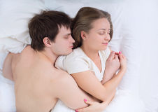Young couple sleeping in bed. Romantic young couple sleeping in bed Royalty Free Stock Photo