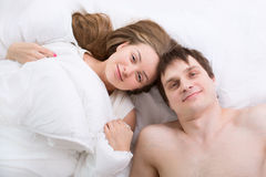 Young couple sleeping in bed. Romantic young couple sleeping in bed Stock Photo
