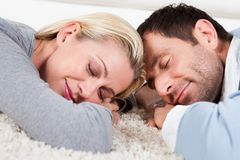 Young couple sleeping at home. On the floor Royalty Free Stock Photography