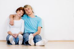 Young couple sleeping indoors Stock Photography