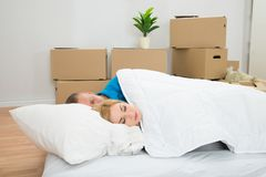Young Couple Sleeping On Mattress Royalty Free Stock Photo