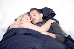 Young couple sleeping peacefully in bed Royalty Free Stock Images