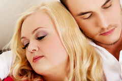 Young couple sleeping on the sofa under blanket Royalty Free Stock Photography