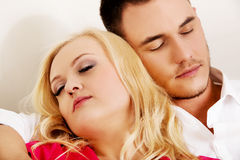 Young couple sleeping on the sofa under blanket.  Royalty Free Stock Photos