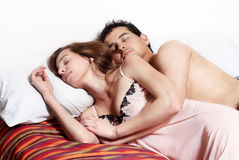 Young couple sleeping together in bed. Royalty Free Stock Photography