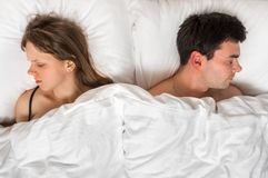 Young couple sleeping together in bed Royalty Free Stock Images