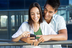 Young couple with smart phone Royalty Free Stock Photo