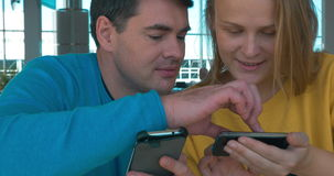 Young couple with smart phones stock video