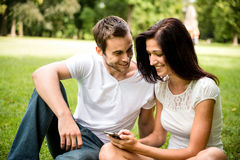 Young couple with smartphone Stock Image