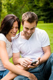 Young couple with smartphone Royalty Free Stock Images