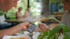 Young Couple with Smartphone and in Cafe. Lifestyle Mobile Technology Footage. HD Slowmotion. Thailand stock video footage
