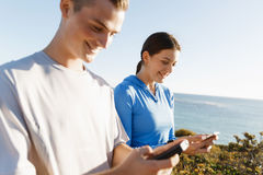 Young couple with smartphones outdoors Stock Photos