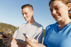 Young couple with smartphones outdoors Stock Photography