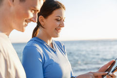 Young couple with smartphones outdoors Stock Images