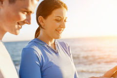Young couple with smartphones outdoors Royalty Free Stock Photography