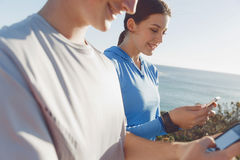 Young couple with smartphones outdoors Stock Image
