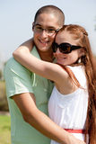 Young couple smile. Happy young couple smile and hug, outdoor stock photo
