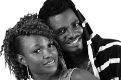 Young couple smiling. Young African American couple smiling at the camera in black and white Stock Photography