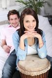 Young couple smiling with a djembe Stock Photos