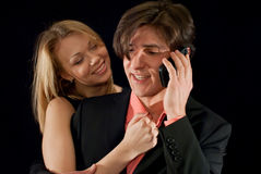 Young couple smiling at each other Stock Image