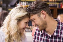 Young couple smiling at each other Royalty Free Stock Photo