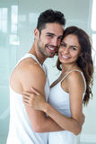 Young couple smiling while embracing at home Stock Photos