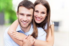 Young couple smiling. Happy young couple hugging and smiling royalty free stock images